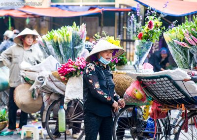 Hanoi woman selling flowers